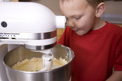 Boy watching mixer Stock Photo