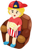 Boy watching movies Royalty Free Stock Image