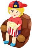 Boy watching movies Royalty Free Stock Image
