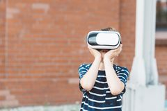 Boy watching simulation in virtual reality googles. Little child boy watching simulation in virtual reality googles Stock Image