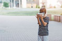 Boy watching simulation in virtual reality googles. Little child boy watching simulation in virtual reality googles Royalty Free Stock Photography