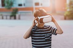 Boy watching simulation in virtual reality googles. Little child boy watching simulation in virtual reality googles Royalty Free Stock Images