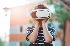 Boy watching simulation in virtual reality googles. Little child boy watching simulation in virtual reality googles Stock Photography