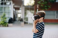 Boy watching simulation in virtual reality googles. Little child boy watching simulation in virtual reality googles Stock Images