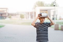 Boy watching simulation in virtual reality googles. Little child boy watching simulation in virtual reality googles Stock Photos