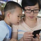 Boy watching smartphone Royalty Free Stock Photo