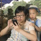 Boy watching smartphone Stock Photography