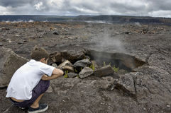 Boy Watching Steam Coming Out Of Lava Hole. Stock Images