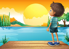A boy watching the sunset. Illustration of a boy watching the sunset Royalty Free Stock Photo