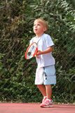 Boy watching tennis ball Stock Photo