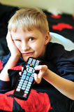 Boy watching tv Royalty Free Stock Photos