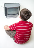 Boy watching tv. A young teenager boy watching tv Royalty Free Stock Photos