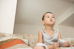 Boy watching TV. Chinese boy watching TV at home Stock Photos