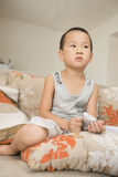 Boy watching TV. Chinese boy watching TV at home Royalty Free Stock Image