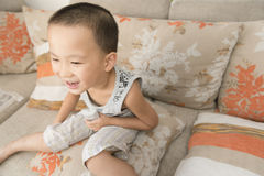 Boy watching TV. Chinese boy watching TV at home Stock Photography