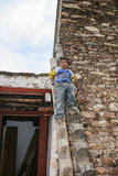 The boy on the watchtower in danba,sichuan,china Stock Photos