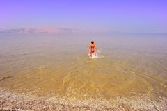 Boy In Water. Happy Boy Running In Water Of Galilee Sea, Kinneret, Early In The Morning Royalty Free Stock Image
