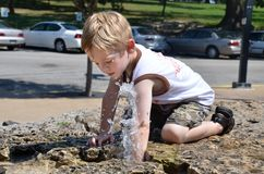 Boy with water Royalty Free Stock Photography