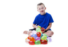 Boy with water balloons Royalty Free Stock Image