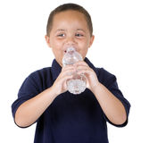 Boy with water bottle. Happy latino boy drinking from water bottle on white background Stock Image