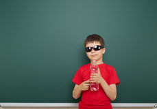 Boy with water bottle and school board Stock Images