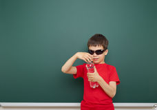 Boy with water bottle and school board Stock Image