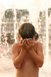 Boy In Water Fountain Royalty Free Stock Image