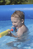 Boy with water gun Royalty Free Stock Photo