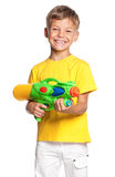 Boy with water gun. Happy boy with plastic water gun isolated on white background royalty free stock photo