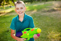 Boy with water gun Royalty Free Stock Image