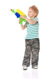 Boy with water gun. Happy boy with plastic water gun isolated on white background stock photos