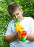 Boy with water pistol royalty free stock image