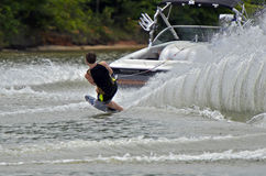 Boy Water Skiing. Young boy behind a boat during a ski competition royalty free stock image