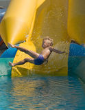 Boy on water slide. Young boy on water slide at a vacation resort Royalty Free Stock Photography
