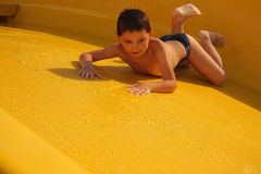 Boy on water slide Royalty Free Stock Photos