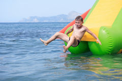 Boy On Water Slide Stock Image