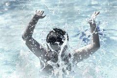 Boy in water summer splash  Stock Image