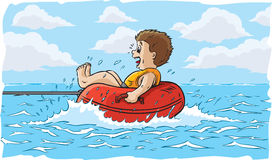 Boy water tubing Stock Photo