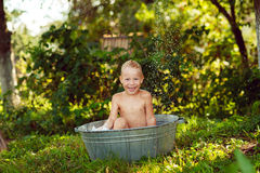 Boy watered. Boy splashing in the water royalty free stock photo