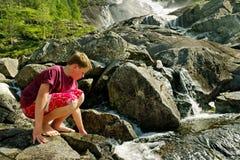 Boy at the waterfall. royalty free stock photo