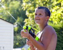 Boy with watergun Royalty Free Stock Image
