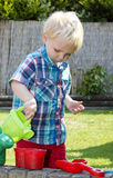 Boy with watering can Royalty Free Stock Images