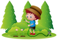 Boy watering flowers in the garden Stock Images