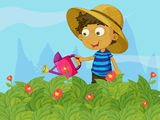A boy watering the plants in a garden Stock Image