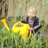 Boy watering sprout Royalty Free Stock Images