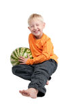 Boy and watermelon. Smiling boy sitting with a watermelon on his side Stock Images