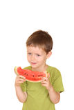 Boy and watermelon Stock Photography