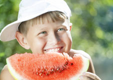 Boy and watermelon Royalty Free Stock Photos