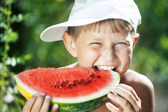 Boy and watermelon Stock Image