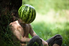 Boy with a watermelon instead of head Royalty Free Stock Photos